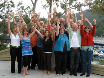 Group SaltSpring Island, hands in air